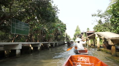 Cruising on boat in floating Market popular destination landmark of Thailand Stock Footage