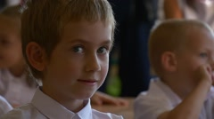 Pupil of First Class Sits at a School Lesson During Celebrating of Day of Stock Footage
