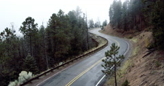 Car driving on foggy mountain road, Santa Fe, New Mexico, United States Stock Footage