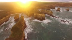 Beautiful cinematic circular pan over Island Archway rock at sunrise Stock Footage