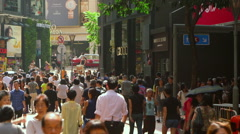PEDESTRIANS JARDINES STREET CAUSEWAY BAY HONG KONG Stock Footage