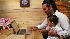 Father post on laptop Stock Footage