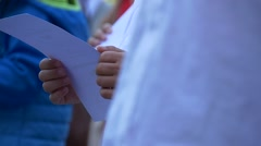 First Grade Student Received a Certificate. Child Considers the Document. Stock Footage