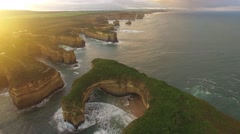 Static aerial shot of Mutton Bird Island rock formation and rugged coastline Stock Footage