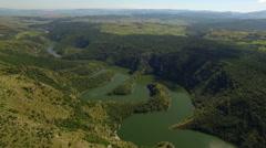 Aerial: camera flying sideways toward beautiful Uvac lake in serbia. Stock Footage