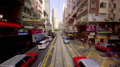 TRAMS STATIONARY TRAFFIC WAN CHAI HONG KONG CHINA Stock Footage
