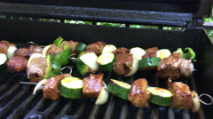 Grilling beef kabobs Stock Footage