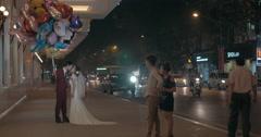 Wedding couple with balloons having photo shoot. Hanoi, Vietnam Stock Footage