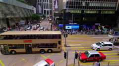 BUSES PEDESTRIANS CROSSING CENTRAL HONG KONG CHINA Stock Footage