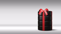 The wheels with new tires are stacked and packaged as a gift, alpha matte Stock Footage