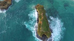 Aerial static shot looking straight down on vegetation-covered rock formation Stock Footage