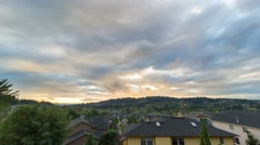 Time lapse of fiery sunset over suburb homes in Happy Valley Oregon 4k uhd Stock Footage