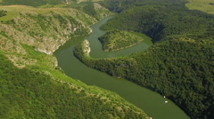 Aerial: camera tilt down pointing at heart of Uvac lake meandre, Serbia. Stock Footage