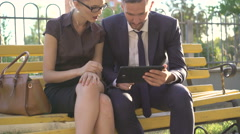Woman and man tread water without getting your feet on the bench outdoor. 4K Stock Footage