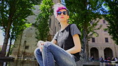 Young girl alternative model with pink hair tattoo in street photo set with glas Stock Footage