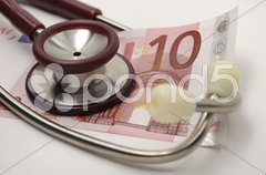 10 Euro Praxisgebühr Stethoskop Stock Photos