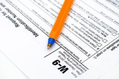 Application form W9 with pen Stock Photos