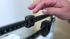 Overweight man weighing himself Stock Footage