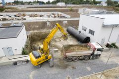 Excavator and truck Wastewater treatment plant Stock Photos