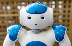Small robot with human face and body. AI Stock Photos