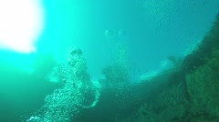 The diver swims under water Stock Footage