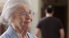 A female elder abuse  victim is intimidated by a male abuser Stock Footage