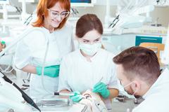 Mastering their skills of future dentists Stock Photos