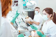 Professional guidance through dental procedures Stock Photos