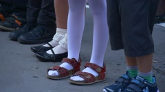Children in the Schoolyard. Foot in the Shoe. Fragment. Slippers, Sandals, Stock Footage