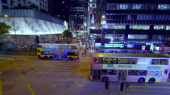 TRAMS BUSES PEDESTRIANS CENTRAL HONG KONG CHINA Stock Footage