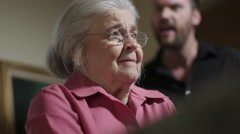 A victim of elder abuse is yelled at by an abusive man Stock Footage