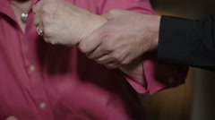 A senior woman suffers elder abuse with an arm grab Stock Footage