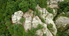 High Aerial of Man Standing on Rock Formation Stock Footage