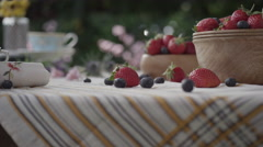 Strawberries and blueberries on table Stock Footage