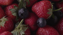 Ripe strawberries and blueberries Stock Footage