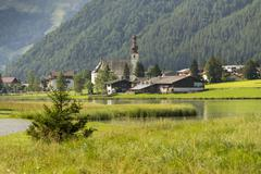 Lake Pillersee with Parisch church in Sankt Ulrich am Pillersee Stock Photos