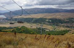 Panorama of Jermuk spa resort city and Arpa river canyon form ropeway station Stock Photos