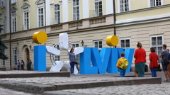 UKRAINE, LVIV, AUGUST 22, 2016: Bus and people near the Market Square Stock Footage
