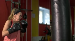 Girl beats a PEAR in the Gym Stock Footage