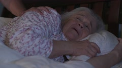 A victim of elder abuse is pushed by an abusive man Stock Footage
