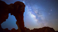 Astro Time Lapse of Milky Way over Elephant Rock in Valley of Fire -Tilt Up- Stock Footage