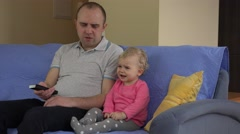 Father change tv channel and daughter girl show negative emotions Stock Footage