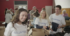 As charity workers and members of the community work together Stock Footage