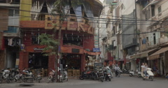 City street with roadside cafe in Hanoi, Vietnam Stock Footage