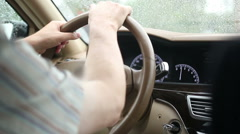 Driving at rainy weather the freeway. Hand on steering wheel Stock Footage