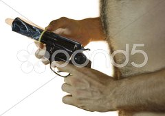Gun with Condom Stock Photos