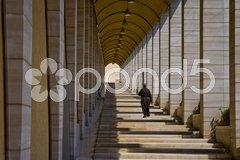 Monk with pillars Stock Photos