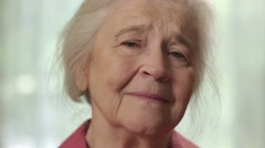Close up of a senior elderly woman looking sad Stock Footage
