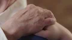 Hand on hand comfort Stock Footage