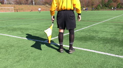 Sideline soccer referee with a flag Stock Footage